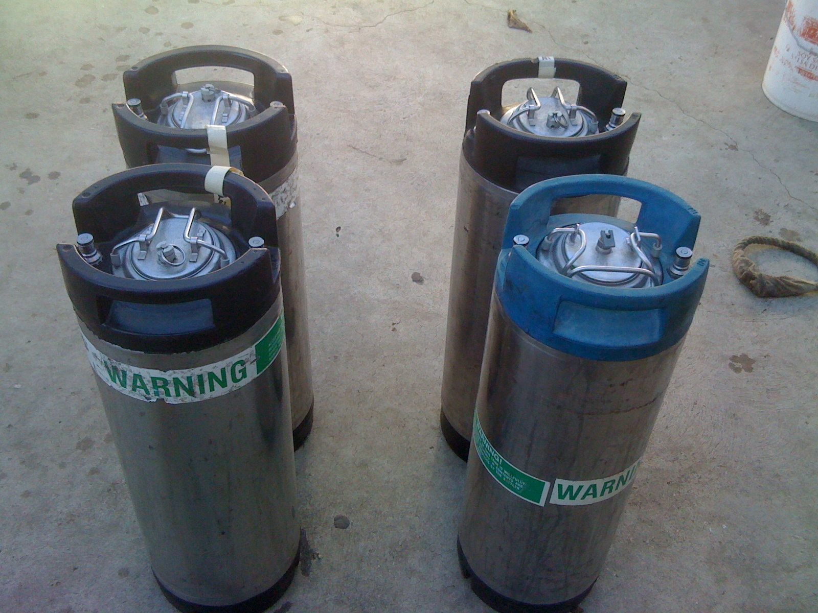 Step One:  2 Kegs w/beer (on the left) & 2 Kegs w/o beer (on the right).