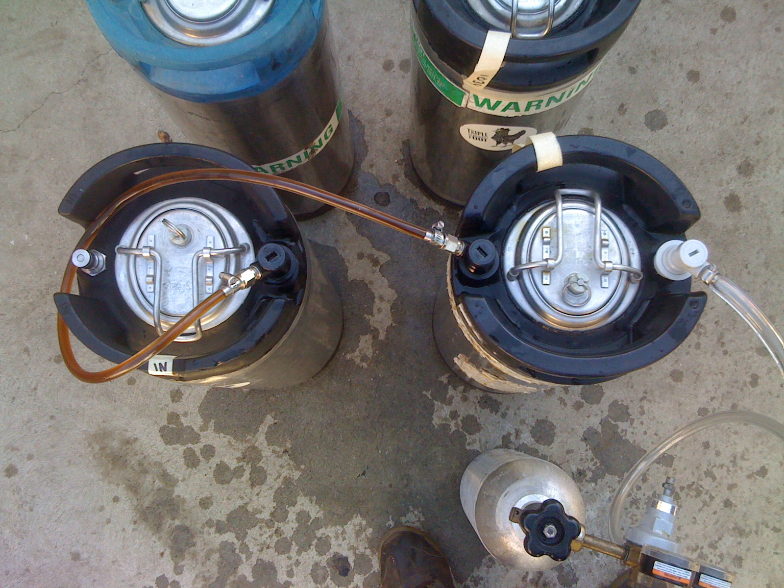 Step 3:  Push beer from full keg to empty keg using CO2.  We filled each keg with 1/2 of the high gravity and half of the lower gravity beer so that they were of equal strength/taste.